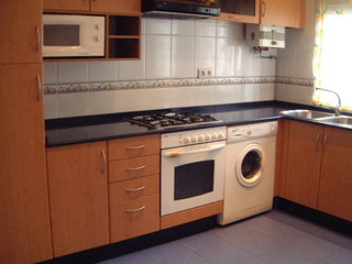 C mo integrar la cocina y lavander a en mismo espacio for Planos de cocina y lavanderia