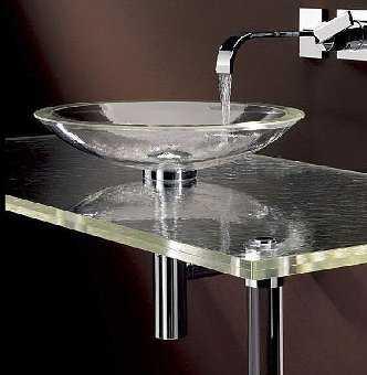 Un ba o con lavabo de cristal ba o decora ilumina for Lavabo vidrio