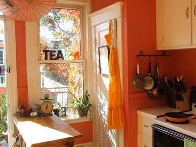 Decorar una cocina de color naranja el tono de moda for Salmon color paint for kitchen